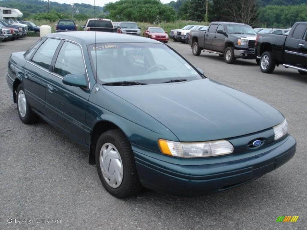 Midnight teal metallic ford taurus