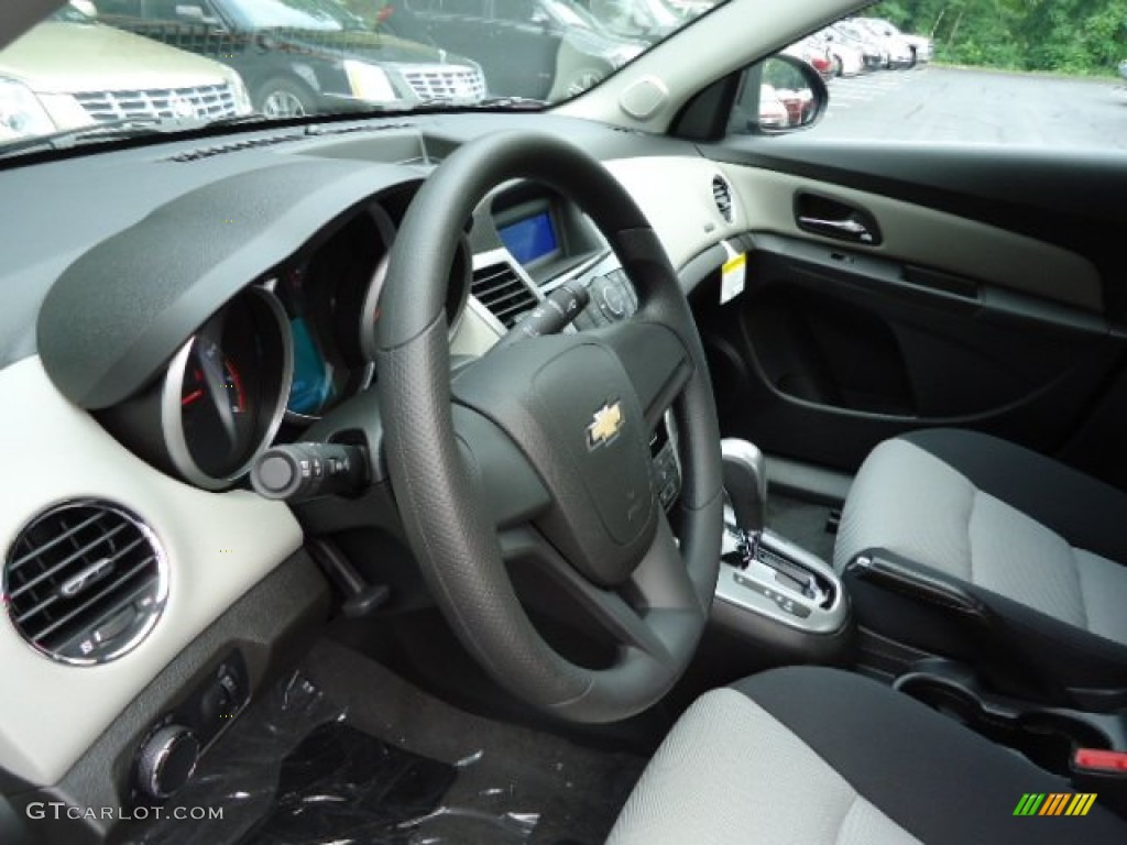 2012 chevrolet cruze ls jet black medium titanium steering. Black Bedroom Furniture Sets. Home Design Ideas