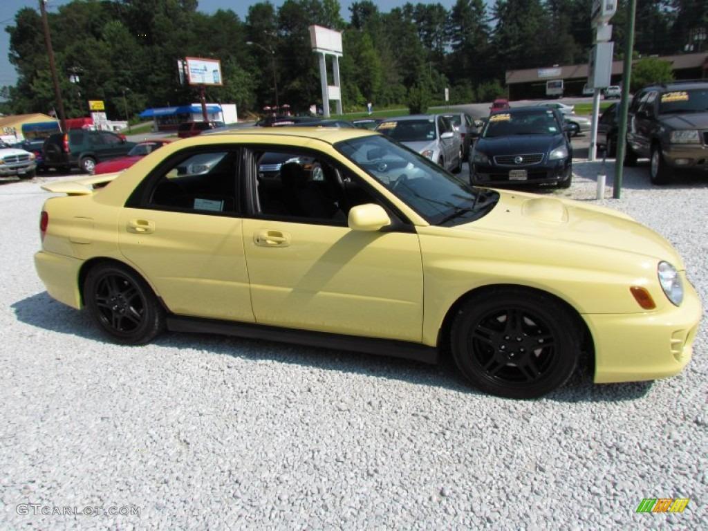 Blaze Yellow 2002 Subaru Impreza WRX Sedan Exterior Photo #68844261