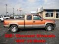 2001 Sunset Orange Metallic Chevrolet Silverado 1500 LS Extended Cab 4x4 #70749537