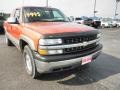 2001 Sunset Orange Metallic Chevrolet Silverado 1500 LS Extended Cab 4x4  photo #2