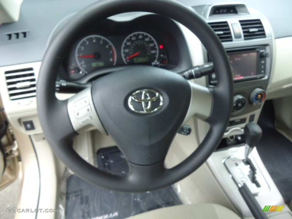 2013 toyota corolla l bisque steering wheel photo. Black Bedroom Furniture Sets. Home Design Ideas