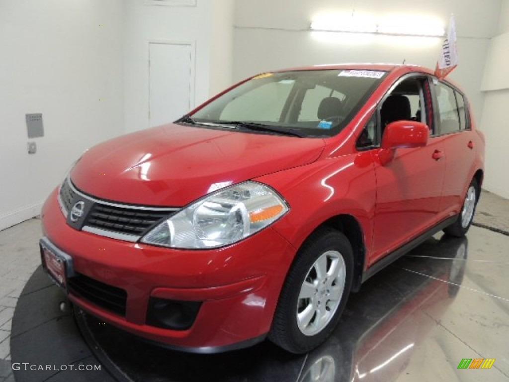2009 red alert nissan versa 1 8 s hatchback 71132543. Black Bedroom Furniture Sets. Home Design Ideas