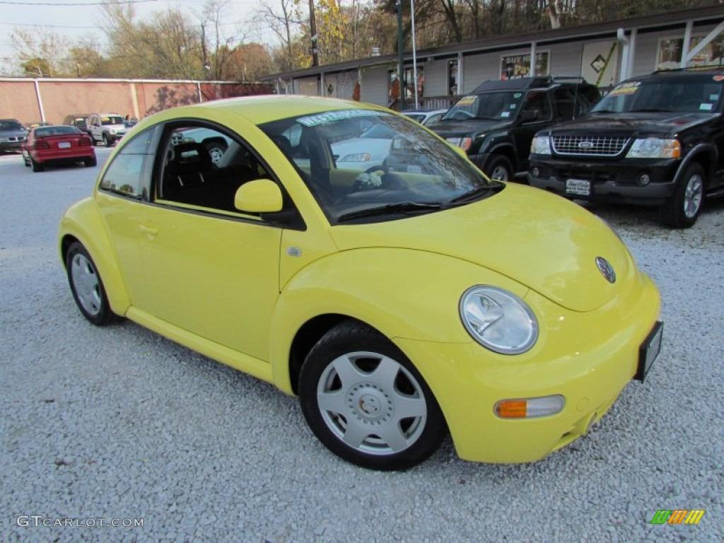 Yellow volkswagen new beetle