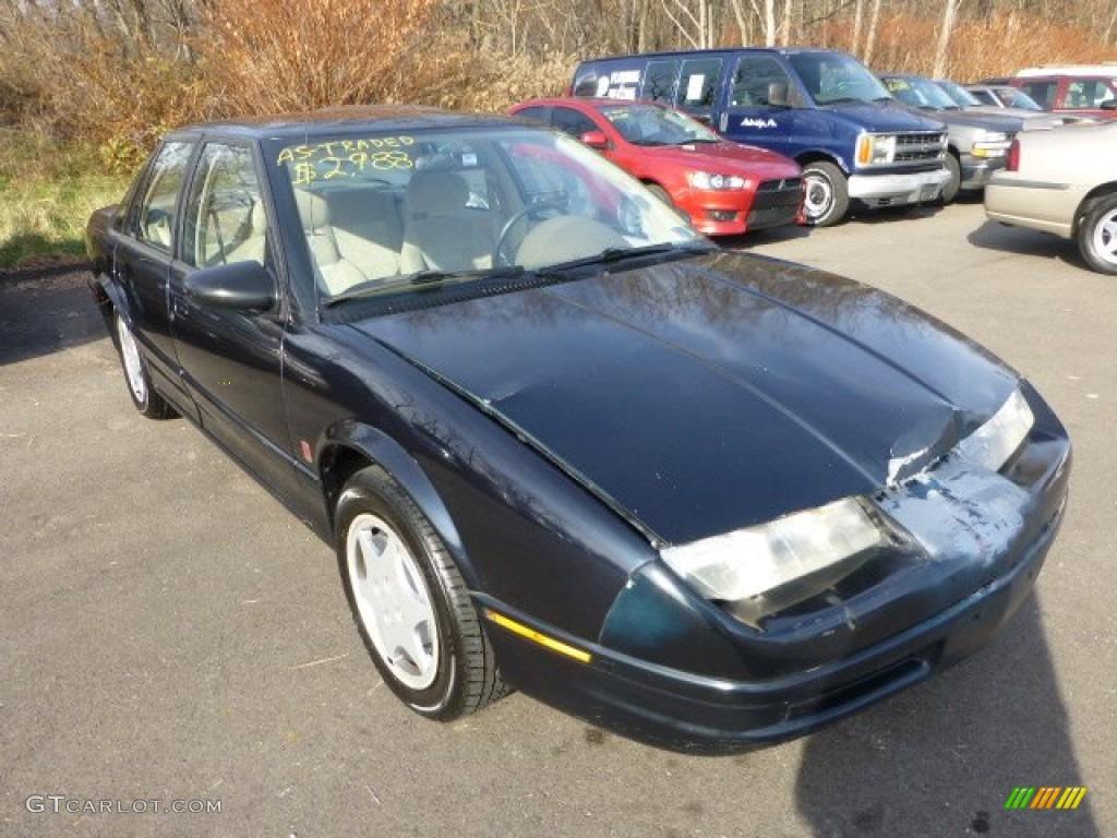 1995 s series sl2 sedan black sapphire metallic tan photo 1