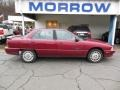 Medium Red Metallic 1998 Oldsmobile Achieva SL