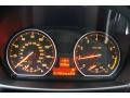 2011 BMW 1 Series Coral Red Interior Gauges Photo