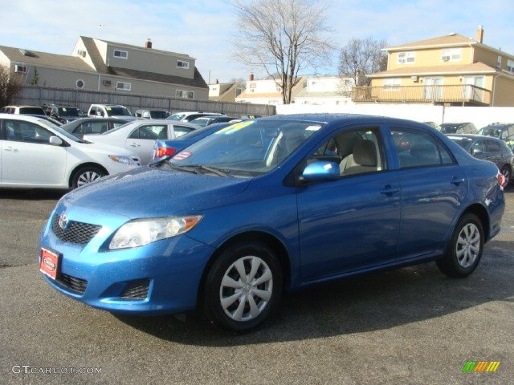 blue streak metallic 2009 toyota corolla le exterior photo