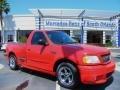 Bright Red 1999 Ford F150 SVT Lightning