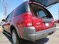 2003 Redfire Metallic Ford Explorer XLS  photo #10