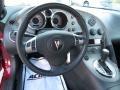 2009 Pontiac Solstice Ebony/Sand Interior Steering Wheel Photo