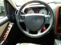 2010 Ford Explorer Black/Camel Interior Steering Wheel Photo