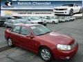 Medium Red 2003 Saturn L Series L300 Sedan