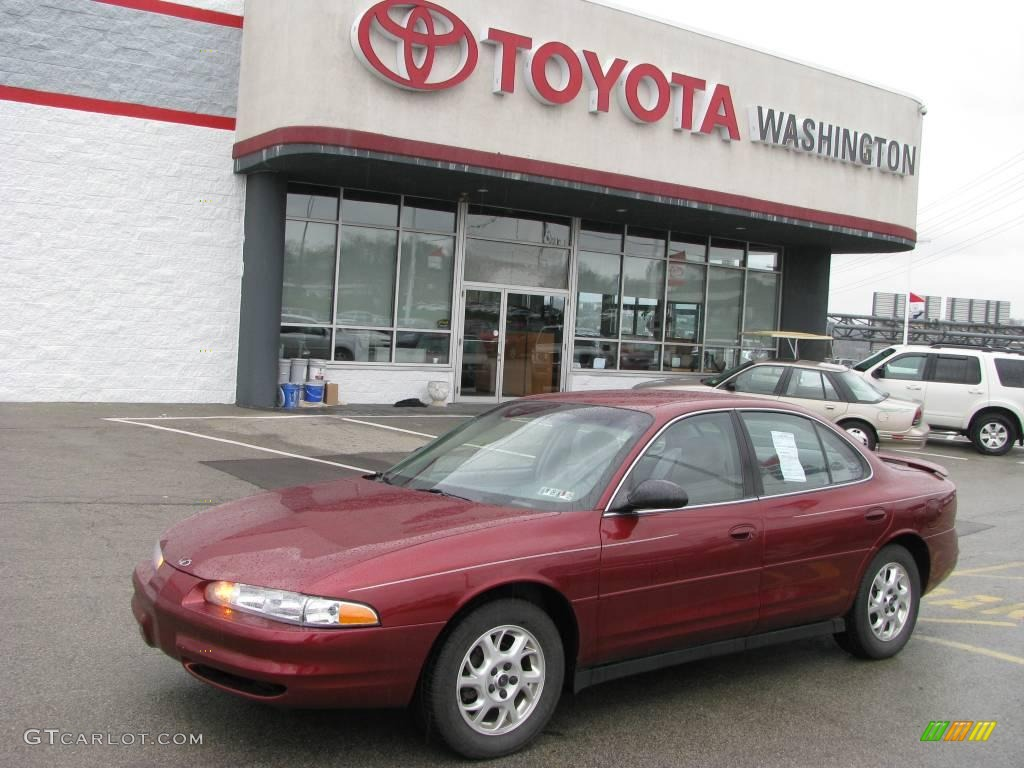 Ruby red oldsmobile intrigue