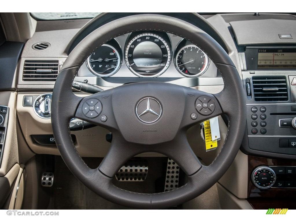 2011 mercedes benz c 300 luxury steering wheel photos for Mercedes benz steering wheel control buttons