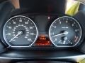 2011 BMW 1 Series Savanna Beige Interior Gauges Photo