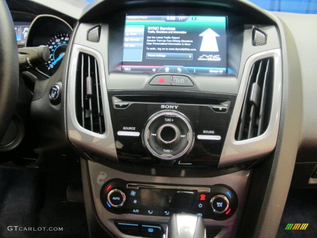 2012 Focus Titanium Sedan - White Platinum Tricoat Metallic / Charcoal Black photo #26