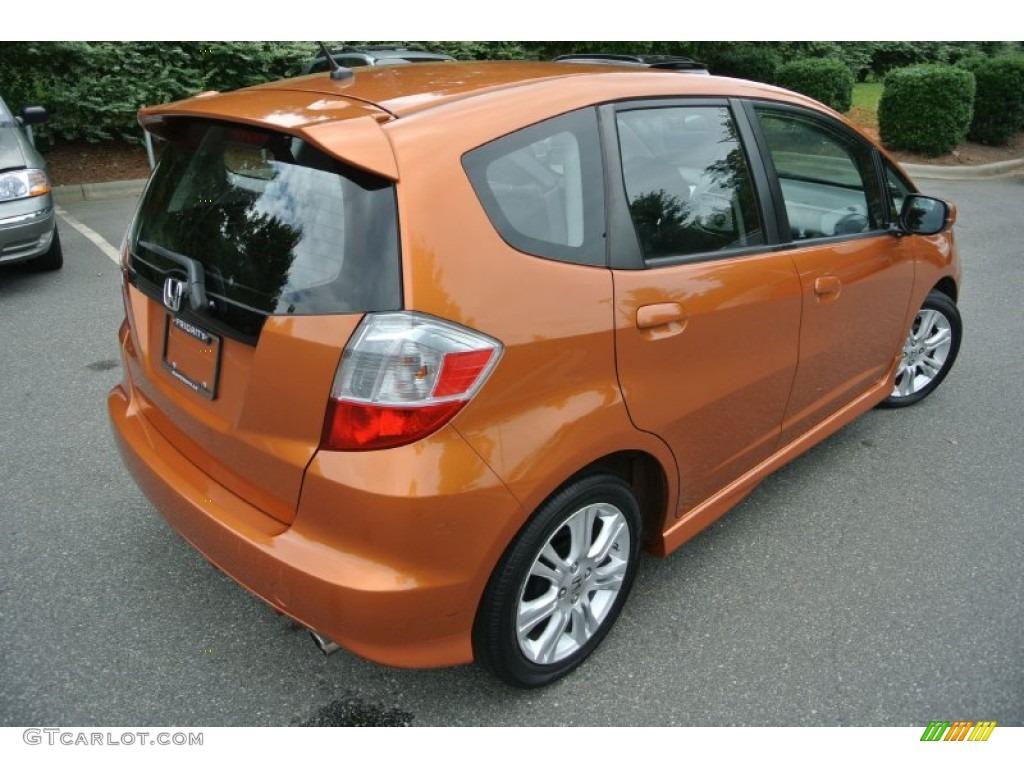 Orange revolution metallic 2010 honda fit sport exterior for Orange honda fit