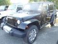 Black 2014 Jeep Wrangler Unlimited Sahara 4x4