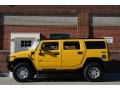Yellow 2003 Hummer H2 SUV