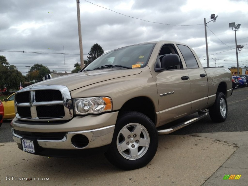 2005 Ram 1500 SLT Quad Cab 4x4 - Light Almond Pearl / Dark Slate Gray photo #1