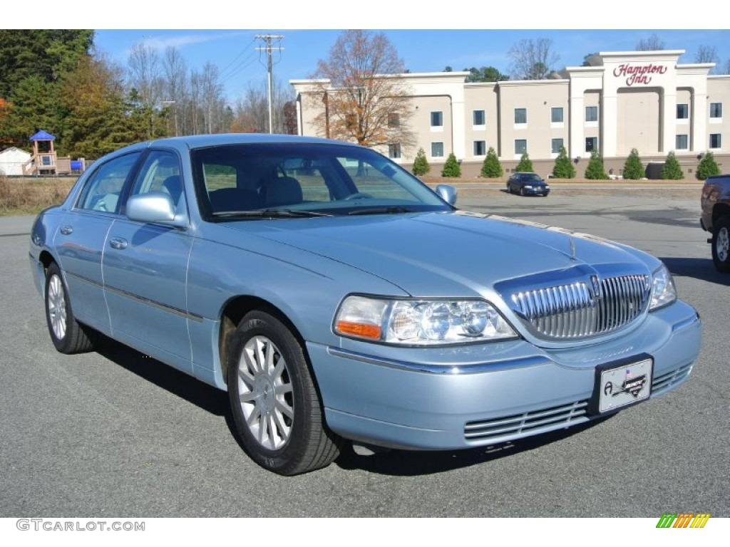 Light ice blue metallic lincoln town car