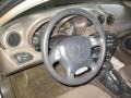 1999 Pontiac Grand Am Camel Interior Steering Wheel Photo