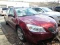 Performance Red Metallic 2009 Pontiac G6 GT Sedan