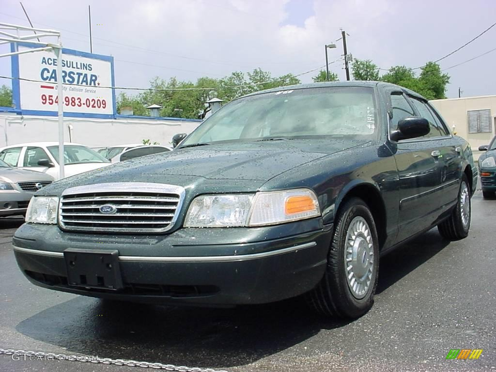 dark green satin metallic ford crown victoria police interceptor  photo