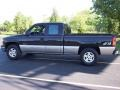 2002 Onyx Black Chevrolet Silverado 1500 LS Extended Cab 4x4  photo #1