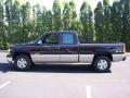 2002 Onyx Black Chevrolet Silverado 1500 LS Extended Cab 4x4  photo #34