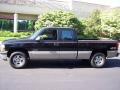 2002 Onyx Black Chevrolet Silverado 1500 LS Extended Cab 4x4  photo #43